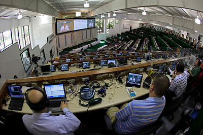 Reporters watch Tiger Woods' news conference from the media center at the Masters golf tournament in Augusta, Ga., Monday, April 5, 2010. The tournament begins Thursday, April, 8. (AP Photo/Charlie Riedel)