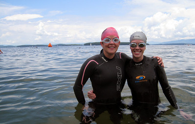 Aimee and Kelly modeling their wetsuits in Lake Winnipesaukee, NH