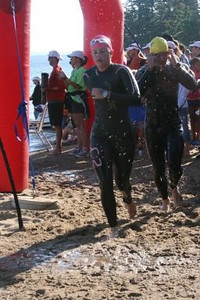 Aimee exiting the swim, ready for the wetsuit strippers!