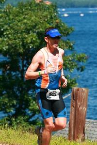 Peter on run in front of beautiful Lake Winipausaukee