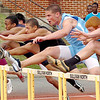 Runners in the boys 110 meter hurdles clear the first hurdle. Photo by ned Jilton II