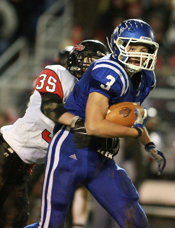 11-22-13<br /> Tipton Semistate<br /> Rensselaer's Sam Ahler tries to tackle Tipton's Brody Dell.<br /> KT photo | Kelly Lafferty