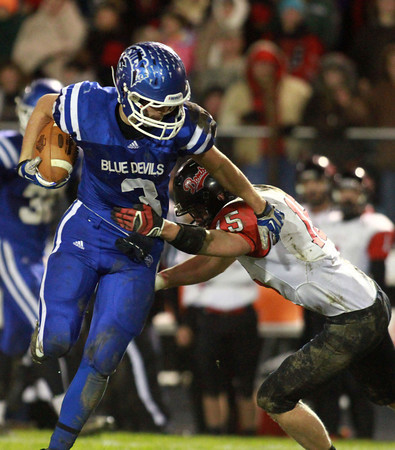 11-22-13<br /> Tipton Semistate<br /> Tipton's Brody Dell tries to outrun Rensselaer's Ab Kiger.<br /> KT photo   Kelly Lafferty