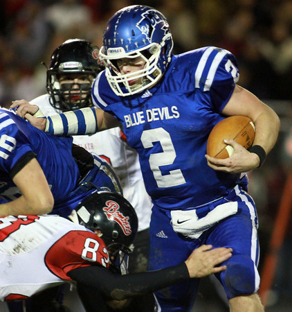 11-22-13<br /> Tipton Semistate<br /> Rensselaer's Dalton Souders tries to tackle Tipton's Austin Hooker.<br /> KT photo | Kelly Lafferty