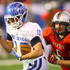 11-30-13<br />   Tipton HS Football State Championship Runner-up<br /> Tipton's Nate Hein running with Ritter's Tommy Waites holding onto his jersey. Hein gained a few more yards.<br />   KT photo | Tim Bath