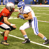 11-30-13<br />   Tipton HS Football State Championship Runner-up<br />   Tipton's Brody Dell returning a kickoff with Ritter's Jack Stinacker<br />   KT photo | Tim Bath