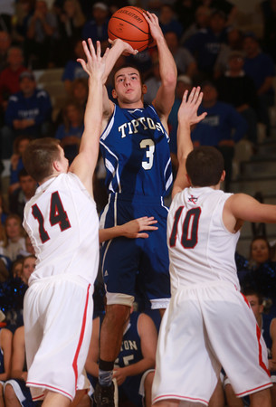 3-15-14<br /> Cass vs. Tipton Regional Championship<br /> Tipton's Mason Degenkolb puts up a shot over Lewis Cass.<br /> KT photo | Kelly Lafferty