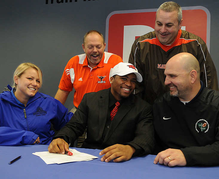 Former Mauldin High School football standout Tiquention Coleman and Spartanburg standout Ronnie Martin signed letters of intent to continue their football careers in college. Coleman signed with Arkansas while Moore signed with South Carolina. D1 Sports on Miller Road hosted the Signing Party.<br /> GWINN DAVIS PHOTOS<br /> gwinndavisphotos.com (website)<br /> (864) 915-0411 (cell)<br /> gwinndavis@gmail.com  (e-mail) <br /> Gwinn Davis (FaceBook)