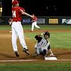 Tivy's Jake Underwood slides safely into third base as Fredericksburg #14 Chase Grona