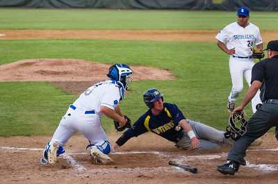 Anthony Quirion slides into home and just eludes the tag of catcher Chad McDaniel.