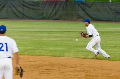 The ball ticks off of Chad Minato's glove for an error in the sixth inning.
