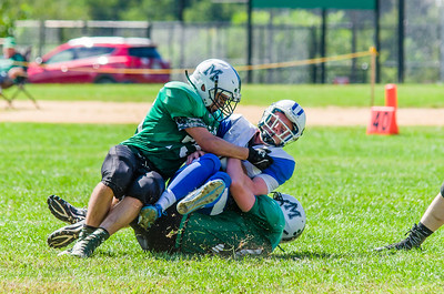 Chad Zappone (75) and Mitchell Mullett combine on a sack of Palmer QB Jeff Pardo during McCann's home opener Saturday.