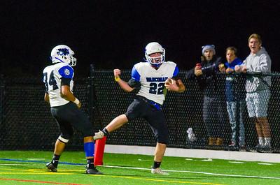Zach Archambault (22) celebrates his 2nd quarter touchdown with Gabe Davis (34).
