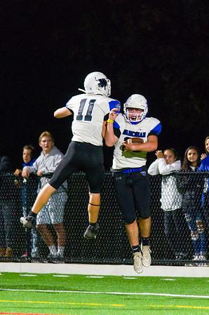 Zach Archambault (22) celebrates his 2nd quarter touchdown with Griffen Salvini (11).
