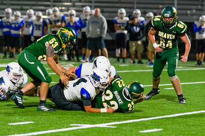 Dylan Burke (22) is brought down deep inside Wahconah territory by Gabe Davis (34).