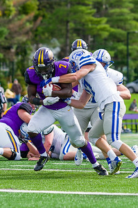 TJ Dozier bulldozes his way through a couple Colby defenders en route to a  touchdown in the third quarter.