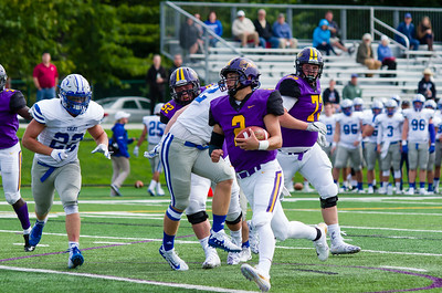 Bobby Maimaron (2) takes advantage of good blocking by Karsten Salveson (73) and Jeffrey MacArthur (52), and steps easily into the end zone during a decisive third quarter for the Ephs.