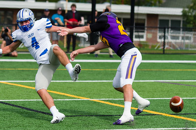 Luke Apuzzi gives Colby receiver Andrew DeFranco an extra shove after deflecting the pass attempt.