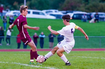 Monument Mountain's Ty Higgens battles for ball posession in the first half against Pittsfield's Sam Higuera (5).