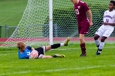 Monument Mountain's Rhys Curtis makes a save on a PHS shot early in the first half.
