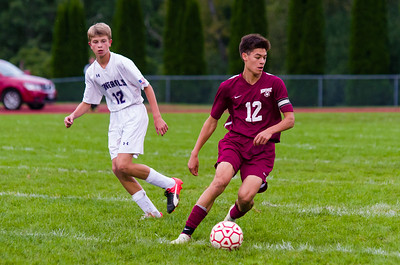 Monument Mountain's Aidan Santos (12) steers the ball away from Pittsfield's Luke Peplowski (12) Thursday.