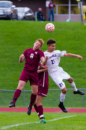 Nick Lussier (8) goes up against Patrick Silva (21) for a header early in the first half of their game Thursday.