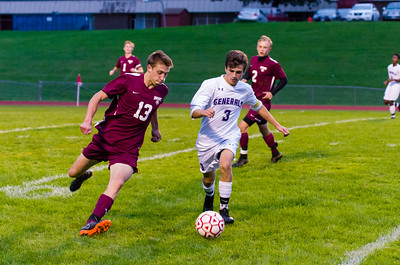 Carter Matthews (3) chases down and steals the ball away from Will Casarsa (13).