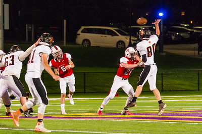 Cole Redstone (80) knocks a Michael Wellspeak out of the air in the 2nd quarter.