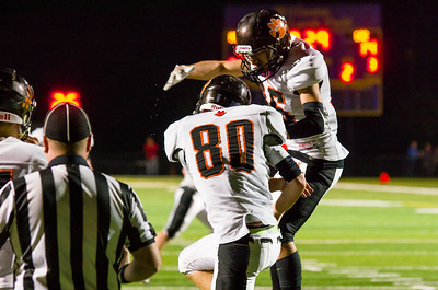 Cole Redstone (80) and J.J. Jiminez celebrate Cole's touchdown catch in the second quarter.