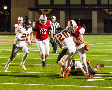 Wildcat's Taggert Roosa (20) forces Mounties Taylor Cummings to fumble in the 2nd quarter, which Lee recovered.