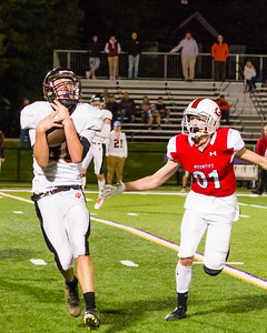 Early in the first quarter, Cole Redstone hauls in a pass that he turns into a touchdown.
