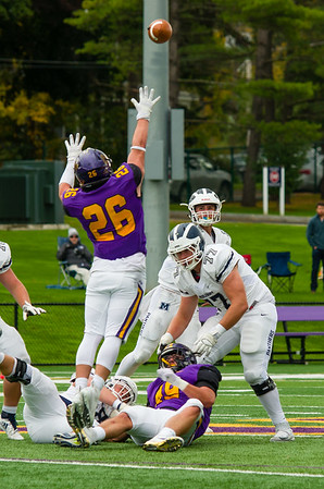 Middlebury QB Will Jernigan's pass sails over the outstretched arms of Christian Dumont (26).