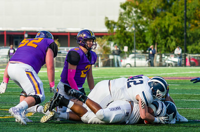 Ephs QB Bobby Maimaron looks on as Middlebury players cover the ball after he fumbled just before halftime.