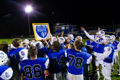 Wahconah players hold up the Route 9 trophy Saturday night after their 49-7 win over Northampton.