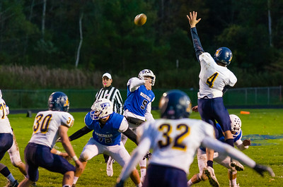 Wahconah's Tim Clayton (5) launches a pass over the outstretched arm of John Turkomer (4).