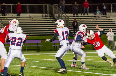 Ryan Goss (50) rushes around Mahar fullback Joey Brozell (34) and would eventually sack Mahar QB Noah Chabot (12) on the final play of the game.