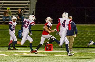 Mt. Greylock's Sean Malloy races past Mahar defenders late in the 4th quarter.