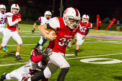 Sean Malloy ducks and weaves through the Senator's defense on a long run in the 4th quarter to put Greylock in good field position.