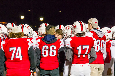 Mounties get a pep talk from their head coach just before scoring the go-ahead touchdown.