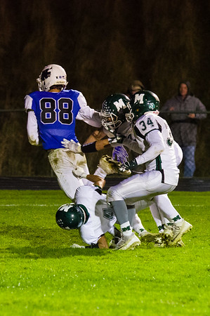 Wahconah receiver Luke Hescock (88) hauls in a pass in the endzone for a touchdown Friday night against Minnechaug.