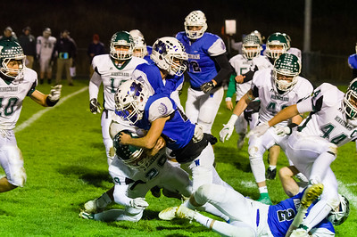 Wahconah's Ian Graham (24) stretches for extra yards on a good run early in the first quarter against Minnechaug.
