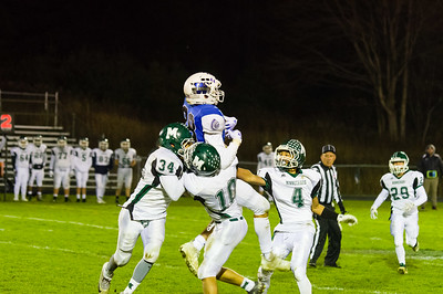 Wahconah receiver Luke Hescock (88) outleaps a host of Minnechaug defenders to make the catch Friday night.