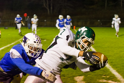 Minnechaug receiver Alex Henry (7) reaches toward the end zone for a 2nd quarter touchdown against Wahconah.