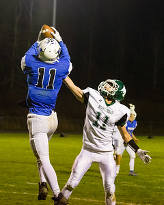 Warriors' Griffin Salvini (11) hauls in a pass over the coverage of the Falcons Ryan Marquez (11).