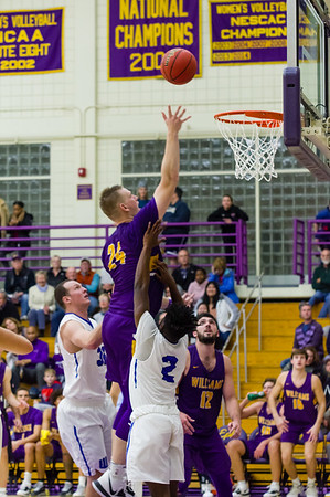 Ephs Matt Karpowicz (24) soars high above  Lancers Jason Truax (32) and Corey Olivier (2) and makes the basket.