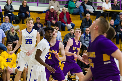 Ryan Moore (2) and Spencer Spivy (11) watch an early shot miss the mark in the Ephs 2019-2020 season opener.