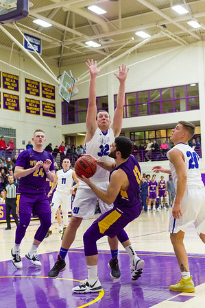 Williams senior Henry Feinberg (12) looks for an opening around Jason Truax (32) during a rough opening 15 minutes for the Ephs.