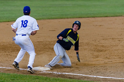 Nighthawk's Gregory Hardison makes it safely to third early in the Steeplecats' home opener.