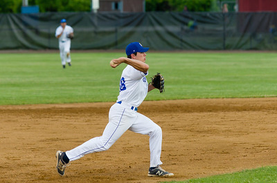 Matt Koperniak scoops up the ball and throws for an out early in the game.