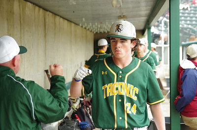 Fist bumps as players prepare for the start of the Division 3 state championship game Saturday vs. Austin Prep.